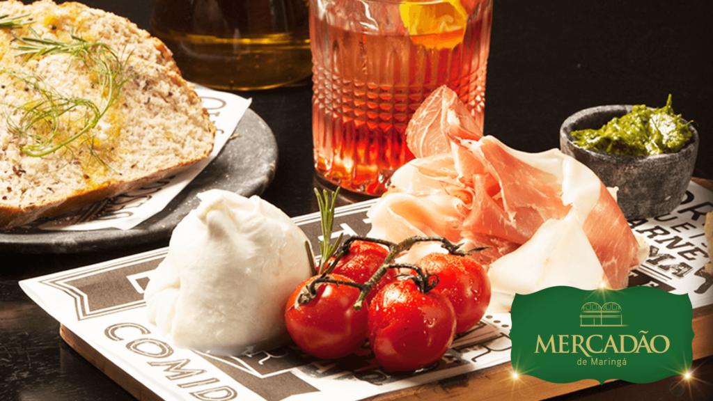 Mannaia - Burrata fresca, presunto de parma acompanhado de pão de fermentação natural, com drink Negroni.